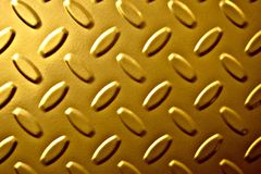Industrial background texture, gold color with raised areas. Gold Industrial background texture, raised oval areas give the picture a dramatic effect royalty free stock photography