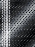 Industrial background with truck tyre on black metallic mesh Royalty Free Stock Images