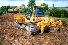 Industrial backhoe truck moving earth and soil in quarry constru Stock Photos