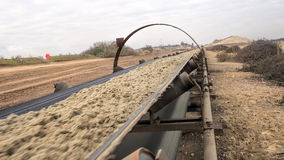 Free Industrial Belt Conveyor Moving Raw Materials. Royalty Free Stock Images - 86537809