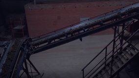 Industrial belt conveyor. Moving Raw Materials. Long conveyor belt transporting ore to the power plant. Extraction of
