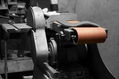Industrial belt sander in a factory workshop royalty free stock photos