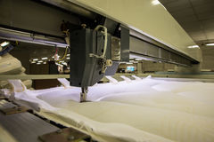 Industrial big embroidery machine on textile Royalty Free Stock Photo