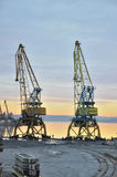 Industrial black sea port - two old cranes Royalty Free Stock Photography