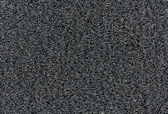 Industrial black vinyl carpet Coil Pattern Car Floor Mat texture Stock Photography