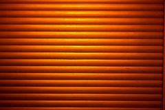 Industrial blinds in yellow light stock photos