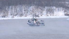 Industrial boat in the winter, sailing in the fog stock video
