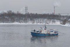Industrial boat in the winter, sailing fog Stock Photography