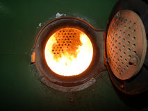 Industrial Boiler Furnace Fire. Detail of a coal-fired boiler on an antique steam ship stock photography