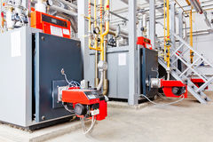 Industrial gas boiler with burner generate heat Stock Photos