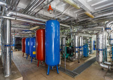 Industrial boiler interior with lots of pipes, pumps and valves Stock Photo