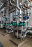 Industrial boiler interior with lots of pipes, pumps and valves Royalty Free Stock Photography