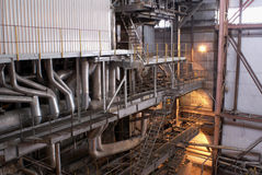 Industrial Boiler and Piping. View of a massive boiler unit and accompanying piping at a large power generating plant Royalty Free Stock Image