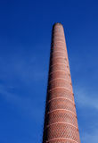 Industrial brick smoke stack Royalty Free Stock Images