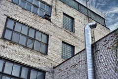 Industrial building. Old industrial building with windows royalty free stock image