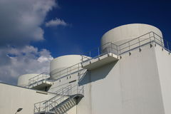Industrial building. With tubes  in blue sky, horizontal Stock Photo