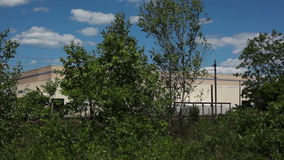 Industrial Building Behind Trees stock video