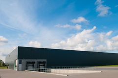Industrial building with loading docks. And blue sky Royalty Free Stock Image