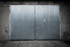 Industrial building made of concrete with door Stock Images