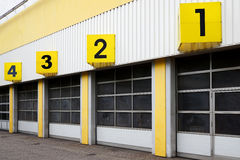 Industrial building with numbered gates royalty free stock photography