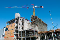 Industrial building site. With tower crane Stock Photo