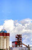 Industrial building. Is a industrial building with sky and clouds Royalty Free Stock Photos