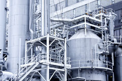 Industrial building and steel pipes Stock Images