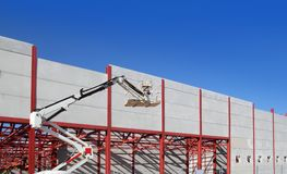 Industrial building steel structure crane. Industrial building construction with steel structure and concrete wall Stock Image