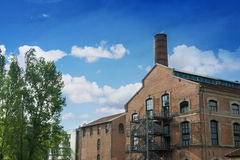Industrial building with a tower and trees Stock Photography