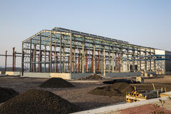 Industrial building under construction. With clear blue sky back ground royalty free stock images