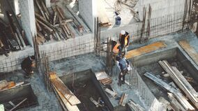 Industrial Building Workers Doing Job Raw Fundament Concrete Cement Using Tools Hard Job Labor Construction In Progress