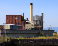 Industrial Buildings. Formerly part of a paper and pulp mill that is being torn down stock image