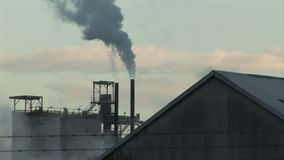 Industrial buildings and chimney smoke and steam. England and industrial landscape with smoking chimney stock footage