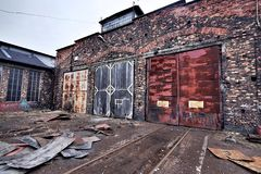 Industrial buildings covered in rust and patina Stock Image