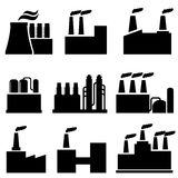 Industrial buildings, factory and pollution. Industrial buildings and factories icon set Stock Photos