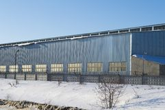 Industrial buildings near the road in winter stock photos