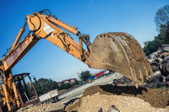 Industrial bulldozer demolishing buildings and working on construction site Royalty Free Stock Image
