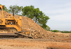 Industrial  bulldozer moving earth  pit or quarry Royalty Free Stock Images