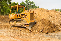 Industrial  bulldozer moving earth  pit or quarry Stock Images
