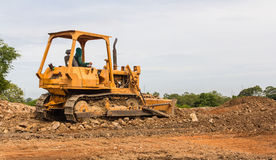 Industrial  bulldozer moving earth  pit or quarry Royalty Free Stock Photos
