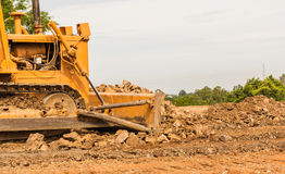 Industrial  bulldozer moving earth  pit or quarry Stock Image