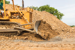 Industrial  bulldozer moving earth  pit or quarry Royalty Free Stock Image