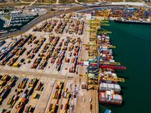 Industrial Cargo area with container ship in dock at port, Aerial view Royalty Free Stock Image