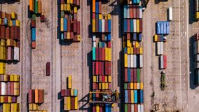 Industrial Cargo area with container ship in dock at port, Aerial view stock footage