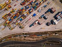 Industrial Cargo area with container ship in dock at port, Aerial view Royalty Free Stock Photos