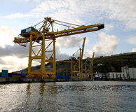 Industrial cargo crane in port. Industrial cargo crane on the shore in industrial port Stock Images