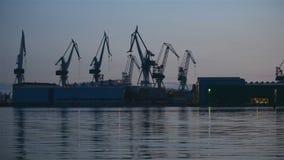 Industrial cargo cranes in the dock stock video footage