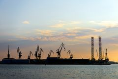 Industrial cargo cranes in the dock Royalty Free Stock Photography