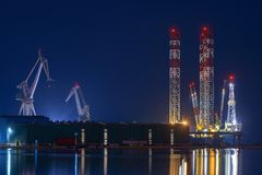 Industrial cargo cranes in the dock Stock Photo