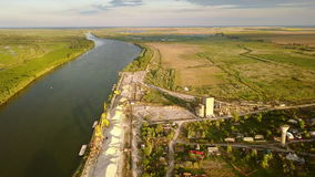 Industrial cargo port with cranes on the Danube river. Aerial view stock video